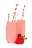 Strawberry milk in bottles over white Royalty Free Stock Photography