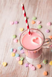 Strawberry milk and conversation hearts. For Valentines Day stock images