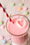 Strawberry milk and conversation hearts Royalty Free Stock Photo