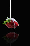 Strawberry and milk on a dark background Royalty Free Stock Photo