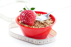 Strawberry,milk,fork,measure tape and wheat Royalty Free Stock Photos