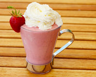 Strawberry milk. With fresh strawberry and whipped cream Stock Images