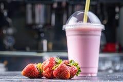 Free Strawberry Milk Shake To Take Away With Straw On A Dark Background Stock Photo - 121685830