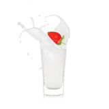 Strawberry with milk splash. Over white Royalty Free Stock Photo
