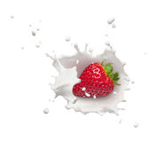 Strawberry with milk splash. Milk splash with strawberry from top view royalty free stock images