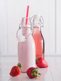 Strawberry milk and strawberry juice in bottles Royalty Free Stock Photo