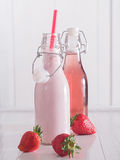 Strawberry milk and strawberry juice in bottles Royalty Free Stock Photos