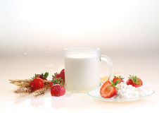 Strawberry and milk on a white background, milk in a transparent. Mug and cottage cheese with a strawberry stock photos