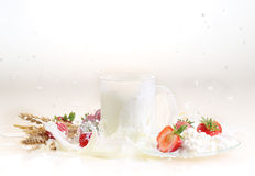 Strawberry and milk on a white background, milk in a transparent. Mug and cottage cheese with a strawberry stock photo