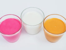 Strawberry milk, white milk and tea milk in glass Stock Photography
