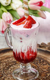 Strawberry milkshake, beautiful bouquet of pink and white tulips Stock Photos