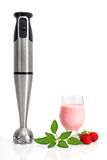 Strawberry milkshake and blender Royalty Free Stock Images