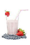 Strawberry milkshake with blueberries stock photography