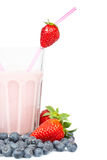 Strawberry milkshake with blueberries Royalty Free Stock Image