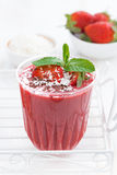 Strawberry milkshake with chocolate and coconut, vertical Royalty Free Stock Photo