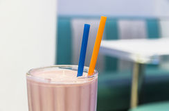 A strawberry milkshake glass with drinking straws Stock Photo