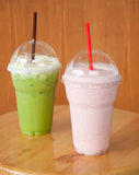 Strawberry milkshake and iced green tea Stock Image