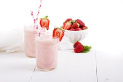 Strawberry milkshake in mason jars Royalty Free Stock Images