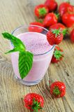 Strawberry milkshake with mint Stock Photos