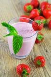 Strawberry milkshake with mint Stock Photos