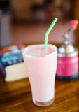 Strawberry milkshake on the table in cafe Royalty Free Stock Image