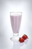 Strawberry milkshake. In a tall glass with fresh srtrawberry Stock Photography