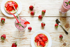 Strawberry milkshake and tartlets, top view Stock Image