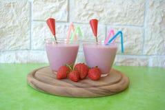 Strawberry milkshakes. Two glasses of strawberry milkshake royalty free stock photography