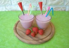 Strawberry milkshakes. Two glasses of strawberry milkshake stock photo