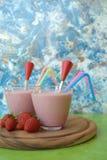 Strawberry milkshakes. Two glasses of strawberry milkshake royalty free stock image