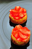 Strawberry mini cheesecakes tarts Stock Photography