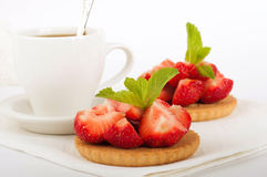 Strawberry with a mint and cup of coffee Royalty Free Stock Image