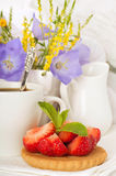 Strawberry with a mint and cup of coffee Royalty Free Stock Photos