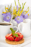 Strawberry with a mint and cup of coffee, f Royalty Free Stock Image