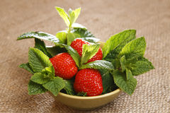 Strawberry and mint leaves in bowl Royalty Free Stock Images