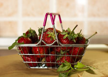 Strawberry and mint in a shopping basket. Strawberry and some mint in a shopping basket Royalty Free Stock Photography