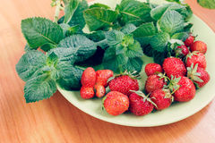 Strawberry and mint, toned effect Stock Photography