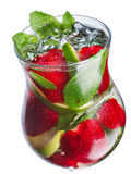 Strawberry mojito closeup. Strawberry mojito in hurricane glass. Cold refreshing cocktail with lime and mint. Traditional mojito with modern twist Stock Image