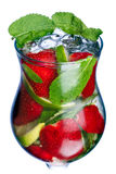 Strawberry mojito closeup. Strawberry mojito in hurricane glass. Cold refreshing cocktail with lime and mint. Traditional mojito with modern twist Royalty Free Stock Photos