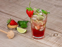 Strawberry mojito cocktail over wooden background Royalty Free Stock Images
