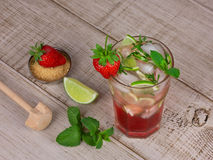 Strawberry mojito cocktail over wooden background Royalty Free Stock Photography