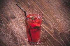 Strawberry mojito cocktail with straw Royalty Free Stock Photography