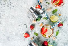Strawberry mojito cocktail. Summer refreshment drink, strawberry mojito cocktail on light concrete background, copy space royalty free stock photo