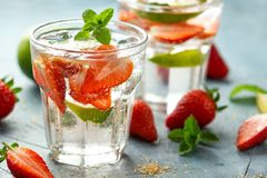 Free Strawberry Mojito Cocktail With Rum, Lime And Mint In Glass. Summer Cold Drink With Ice Stock Image - 148034781