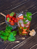 Strawberry mojito cocktail. Strawberry mojito on wooden background Stock Photography