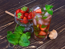Strawberry mojito cocktail. On wooden background Stock Photo