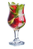 Strawberry mojito. In hurricane glass. Cold refreshing cocktail with lime and mint. Traditional mojito with modern twist Stock Photo