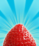 Strawberry Mountain. A ripe strawberry on a star burst background stock photos