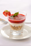 Strawberry mousse. Healthy breakfast. Muesli with strawberry foam and yogurt in a glass Stock Photos