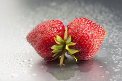 Strawberry, mouth, fruit, red, macro, freshness, w. Two ripe strawberries in mouth shape.  Shoot in studio on silver background with copy space. Dew and droplets Royalty Free Stock Photos